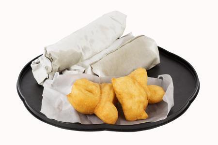 Breakfast Asian Style deep fried dough stick and Roti flat bread on the tray  with paths   photo