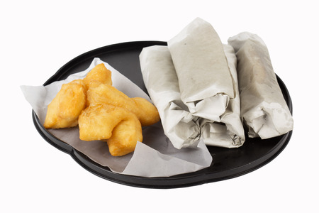 Breakfast Asian Style deep fried dough stick and flat bread on the tray photo