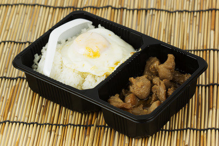 chicken fried garlic with rice in Plastic package photo