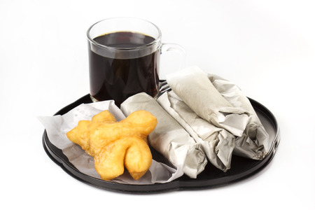 Breakfast Asian Style deep fried dough stick and Roti flat bread on the tray