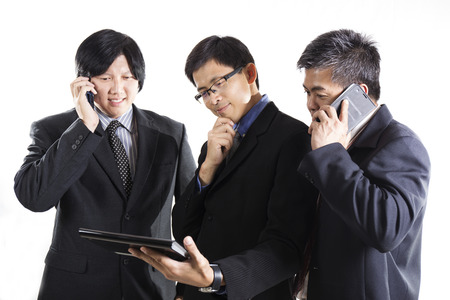 Three Businessman meeting and using mobilephone on white background photo
