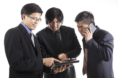 Three Businessman meeting and using mobile phone on white background  photo