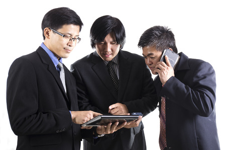 Three Businessman meeting and using mobile phone on white  photo