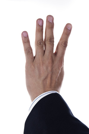 hand and businessman showing four fingers isolated on white  photo