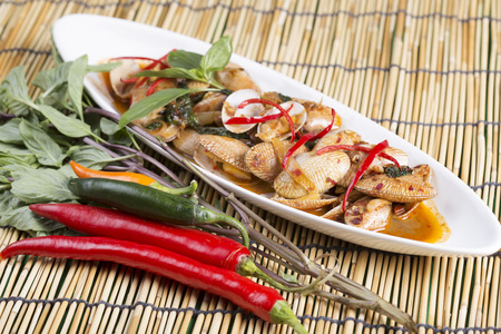 to stir up: Thai spicy food Close up Stir fried clams with roasted chili paste