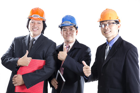 Three Engineers  With Thumb Up Sign Isolated On white  Background photo