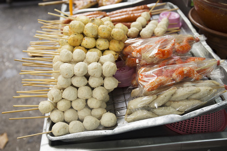 Several Thai meat ball and sausage with bamboo stick, Thai food in Thailand photo