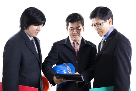 Three Businessman meeting and using Tablet on white background photo