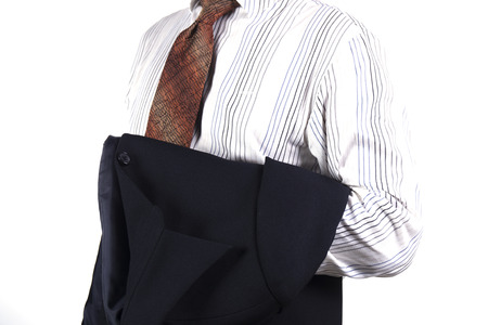 business man holding his suit jacket on white background photo