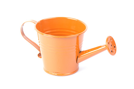 Orange watering can isolated on white background photo