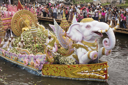 SAMUT PRAKARN,THAILAND-OC TOBER 7, 2014:The Lotus Giving Festival(Rab Bua) in Samut Prakarn,Thailand. Devotees throw lotus flowers to boat procession that carry Buddha statue on October 7,2014