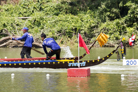 SARABURI, THAILAND - SEPTEMBER 29 : Unidentified crew in traditional Thai long boats compete during Princess Cup Traditional Long Boat Race Championship on September 29, 2014 in SASABURI,Thailand