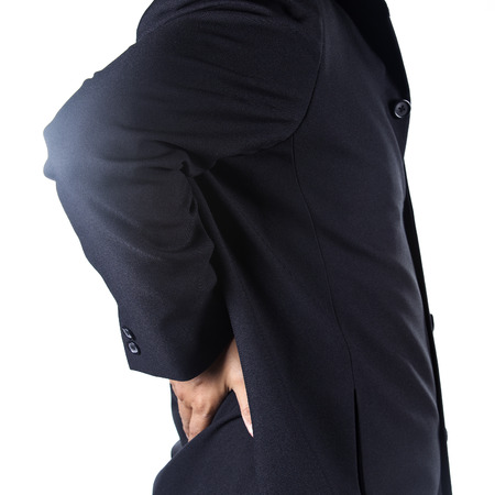 Businessman holding hands on his aching back on white background photo