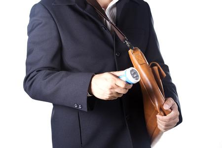 businessman using flashlight Isolated on white background photo