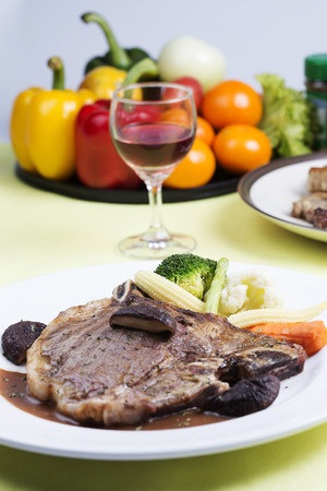 tbone: grilled t-bone steak and vegetables on the table
