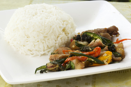 Pad Krapao Kha Moo, spicy stir-fried pork leg with ThaiHoly basil ,Chili and steamed white rice photo