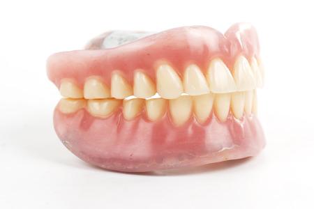 false teeth: false teeth prosthetic isolated on white background