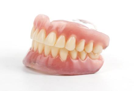 kunstgebit prothese op een witte achtergrond Stockfoto