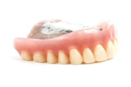 prosthetic: false teeth prosthetic isolated on white background