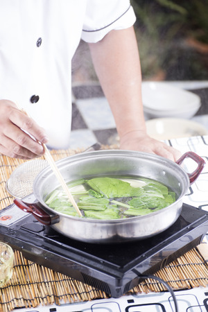 scald: Chef scald vegetable in pot before cooking noodle  Cooking Noodle concept