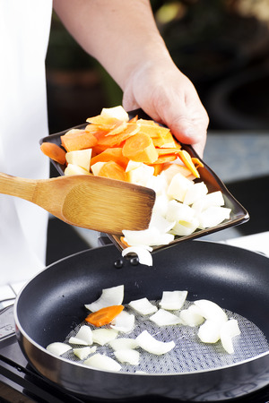 japanes: Chef putting vegetable to the pan for cooking Japanes pork curry  cooking Japanese pork curry concept Stock Photo