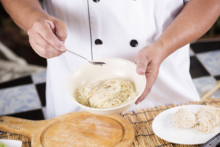 seasoning: Chef cooking Noodle with seasoning sauce  Cooking Noodle concept Stock Photo