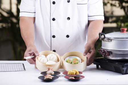 presented: Chef presented Chinese Dim Sum  Cooking Dim sum concept Stock Photo