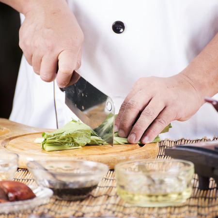 Chef chopping vegetable before cooking noodle  Cooking Noodle concept photo