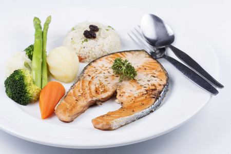 Grilled Salmon steak with Vegetables and Fried Rice photo