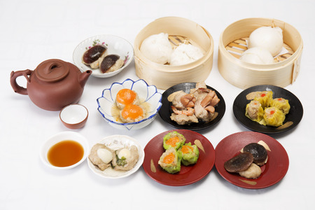 Group of stream Dim Sum chinese food and hot Tea  Cooking Dim sum concept photo