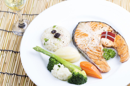 Grilled Salmon steak with Vegetables and white wine photo