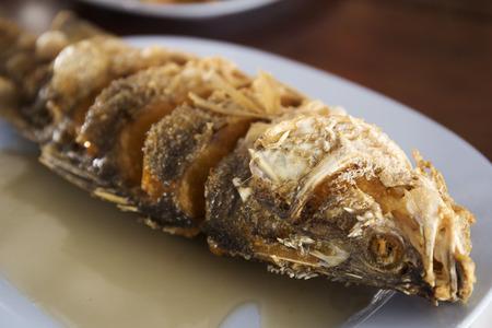 Sea Bass fish deep fried on the plate Stock Photo