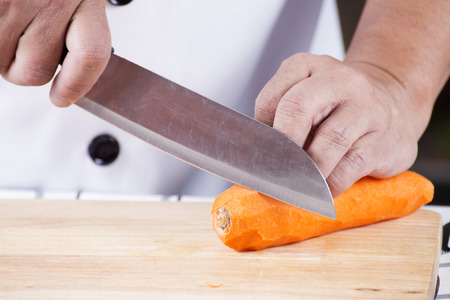 Chef is peeling carrots  cooking Japanese pork curry paste concept Stock Photo