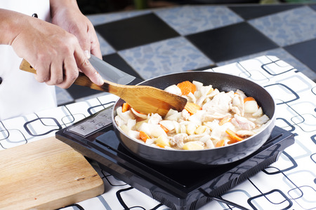 Chef putting slice pf pork to the pan for cooking Japanese pork curry  cooking Japanese pork curry concept Stock Photo