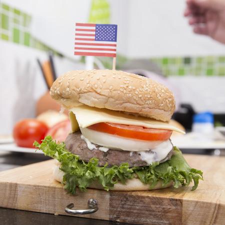 hamburger: Chef cooking and decorated Hamburger with American Flag Cooking Hamburger concept Stock Photo