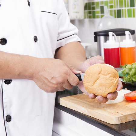 shred: Chef shred burger bun with knife  cooking Hamburger concept