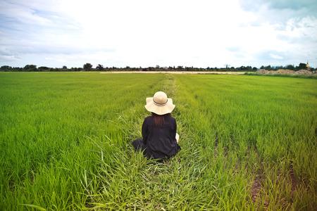 hard work: Female farmer sitting among rice fields in Thailand. Stock Photo