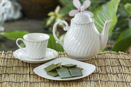 green powder: Matcha green tea chocolate with pot of tea Stock Photo