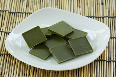 powdered: powdered green tea chocolate on the Plate Stock Photo