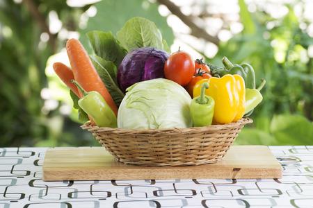 fruits in a basket: Set fresh vegetables on the basket in the garden
