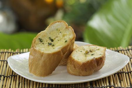 garlic: Slice of Garlic bread on the plate