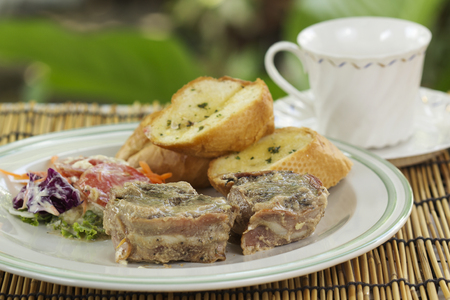 charbroiled: Grilled steak wrapped in bacon with garlic bread