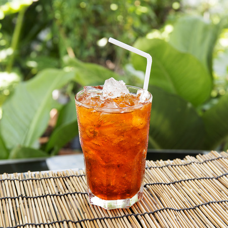 Ice Tea Thai style on the garden background