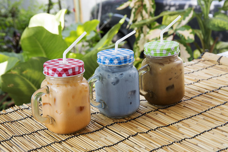 sweet shop: Ice pigeonwings Butterfly Pea ,Tea and coffee Thai style drink Stock Photo