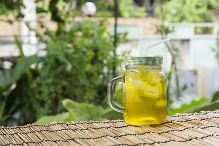 relive: Chrysanthemum tea with ice on garden background