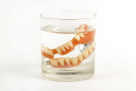 prosthetic: false teeth prosthetic in the glass of water