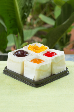 Strawberry, Blueberry, Orange and slice sweet egg mini cake on the box