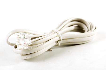 cable telefono: Cable de tel�fono aislado en el fondo blanco