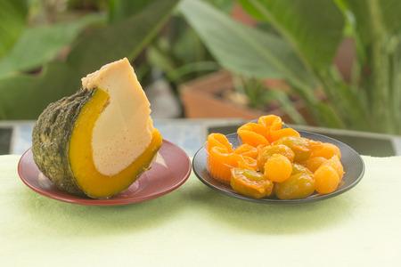 yoke: Half of Egg Custard in the pumpkin and egg yoke fudge balls cooked in syrup  Thai sweet desert Stock Photo