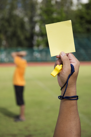 card player: soccer Referee show yellow card recorded player foul in the game